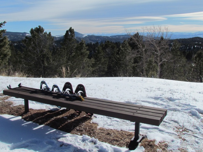 Snowshoeing at Mueller State Park, Colorado, with view of the Western Mountains.