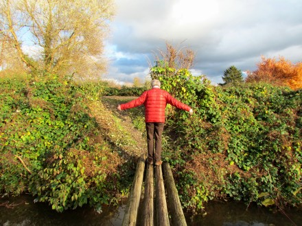 My dad balancing across a bridge