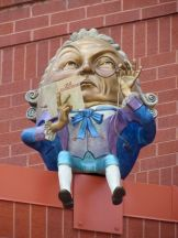 "? Humpty Dickens (he holds ""Great Expectations"")"